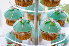 Wedding cupcake tower stand with turquoise cakes. Stock Photo