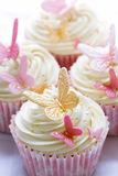 Wedding cupcakes. Cupcakes decorated with pink and gold fondant butterflies Stock Photo