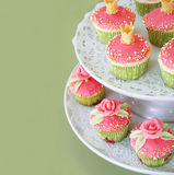 Wedding cupcakes. Vanilla cupcakes decorated with fondant roses. Copyspace to the left Stock Image