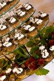 Wedding cupcakes. Cupcakes on a glass display at a wedding Royalty Free Stock Photos