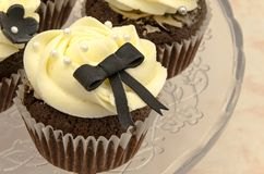 Cupcakes. Wedding cupcakes with butter cream and a ribon Royalty Free Stock Photography