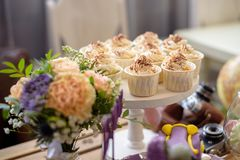 Wedding cupcakes in white foil wrappers, closeup stock photo