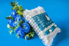 Wedding pillow and flowers stock photos