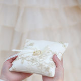 Wedding cushion with gold ring Royalty Free Stock Image
