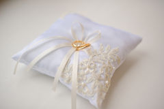 Wedding cushion with gold rings Stock Photography