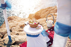 Wedding in cyprus, bride and groom on a stone bridge in Agia Napa. arch and table for registration of marriage. The view Royalty Free Stock Images
