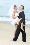 Wedding dance. On the tropical beach Stock Photos