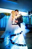 Wedding dance the bride and groom. On a blue background Royalty Free Stock Photography