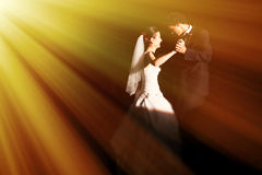 Wedding dance. Couple on floor with streaming light during wedding dance Royalty Free Stock Image