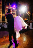 Wedding dancing. The groom holds the bride on hands stock photography