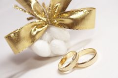 Wedding day 05. Wedding rings and candies Royalty Free Stock Image