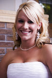 Wedding day. Smiling bride posing before the wedding Royalty Free Stock Photography