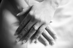 Wedding day. Bride with hands in lap Royalty Free Stock Photos