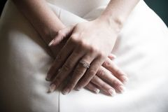 Wedding day. Bride with hands in lap Stock Image