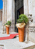 Wedding day. Perspective of a church with flowers basket for a wedding Royalty Free Stock Photos