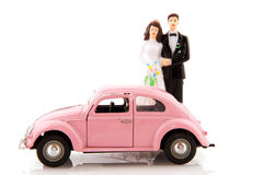 Wedding day. With pink car and couple Royalty Free Stock Photography