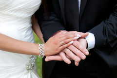 Wedding Day. A couple holding hands together with their rings showing Royalty Free Stock Photos