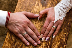 Wedding Day. Bride and Grooms hands With Rings Stock Images