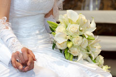 Wedding Day. Bride and Grooms hands With Wedding Bouquet Royalty Free Stock Photography