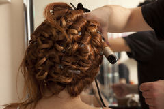 Wedding day. Bride having hairdo on her wedding day Royalty Free Stock Photo
