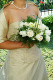 The wedding day. White wedding flowers in the bride's hands Stock Photography