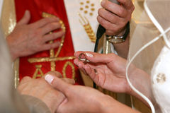 Wedding Day. Bride with brodegroom's ring and priest in the church Royalty Free Stock Photography