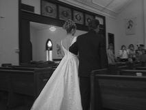 Wedding day. Bride and father walk down the aisle Stock Photography