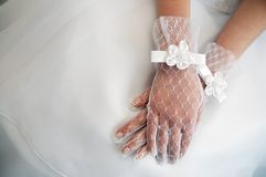 Wedding day. Bride's hands on dress Stock Photo