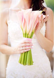 Wedding day. A beautiful bride hold bouquet flower Royalty Free Stock Image
