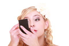 Wedding day. Beautiful bride looking in mirror Stock Image