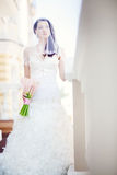 Wedding day. Beautiful young bride hold a bouquet flower Stock Images