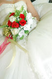 Wedding day. Bridal bouquet of flowers held by bride Stock Image