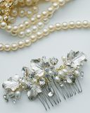 Wedding day bridal hairpiece and pearl necklace close-up royalty free stock photo