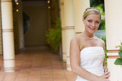 Wedding Day Bride. A pretty young blond haired bride with a happy smile Stock Image