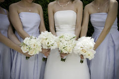 Wedding day. Bride with bridesmaids and bouquets Stock Images