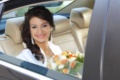 Wedding day. Bride in the car is waiting for the groom Stock Images
