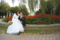 Wedding day. Bride and Groom in the park with the bridal bouquet Stock Images