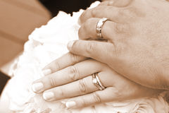 Wedding Day Bride and Grooms hands With Rings Stock Images
