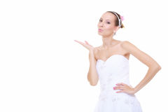 Wedding day. Bride romantic girl blowing a kiss isolated. Wedding day. Young attractive romantic bride girl blowing a kiss isolated on white background Royalty Free Stock Photos