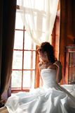 Wedding day bride white. Wedding day bride in traditional white dress in hotel bedroom before marriage ceremony Stock Photos