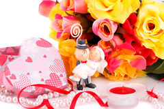 Wedding day. Colorful roses, bride and fiance, candle and gift box close up picture Royalty Free Stock Image