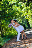 Wedding day. A couple, just married, in the wedding day, having a photo session in the forest royalty free stock photo