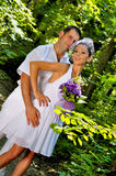 Wedding day. A couple, just married, in the wedding day, having a photo session in the forest royalty free stock photos