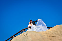 Wedding day. A couple, just married, on the seaside stock photography