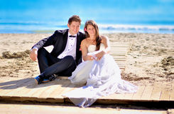 Wedding day. A couple, just married, on the seaside royalty free stock photography