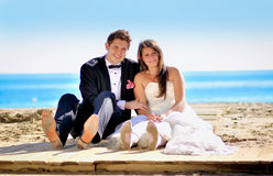Wedding day. A couple, just married, on the seaside stock image