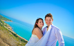 Wedding day. A couple, just married, on the seaside royalty free stock photos