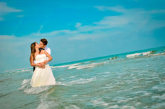 Wedding day. A couple, just married, on the seaside royalty free stock images
