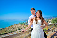 Wedding day. A couple, just married, on the seaside royalty free stock image