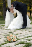 Wedding day dance, kisses and bouquet of flower Stock Images